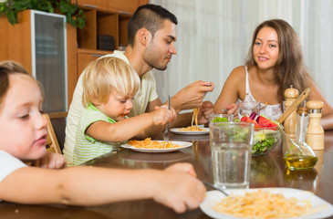 Family eating spaghetti