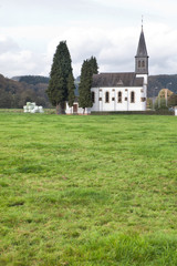 church and green field