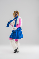 Festive african woman wearing funny costume posing
