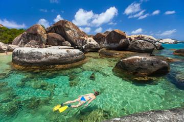 Woman snorkeling at tropical water