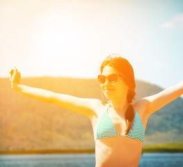 young woman relaxing on the beach (filtered image)