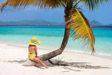 Little girl on beach vacation