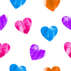 Seamless pattern with colorful hearts over white background.