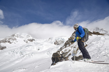 Male skier standing in front of Monte Rosa Glacier