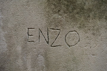 Enzo, masculine italian name carved on a wall