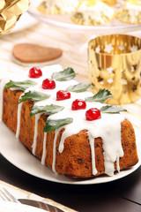 Christmas holly fruitcake on the table