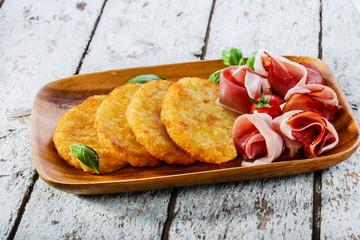 potato pancakes with pancetta and tomato