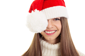 Cute young woman with freckles and Santa hat smiling