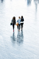 A young women walking in rain