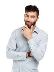 A young bearded man smiling isolated on white
