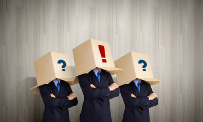 Business people wearing boxes