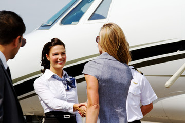 Passengers being greeted by flight crew