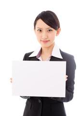 asian businesswoman holding blank whiteboard