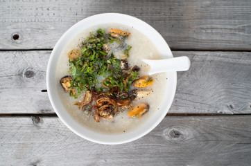 Vietnamese mussels porridge against wooden background