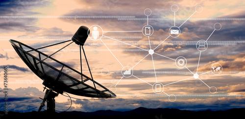 Leinwanddruck Bild satellite dish antennas on sky