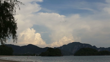 tide of the sea on the background of mountains and clouds