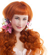 Beautiful red hair woman with long hair.