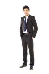 full length young smiling businessman standing
