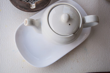 white teapot  for afternoon tea time