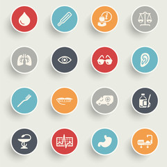 Medicine icons with color buttons on gray background.