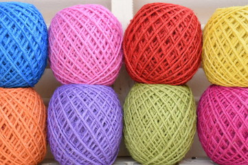 Colorful yarn for crocheting on wooden table