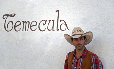 Cowboy Leans Against a Wall