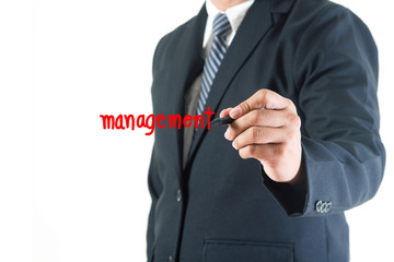 Businessman hand drawing management text in a whiteboard