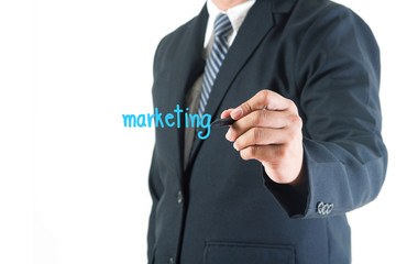 Businessman hand drawing marketing text in a whiteboard