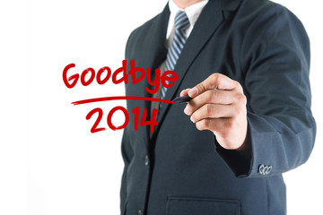 Businessman hand drawing goodbye 2014 on a whiteboard, isolated