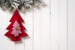 canvas print picture - Christmas decoration with fir branches on the background of a tr