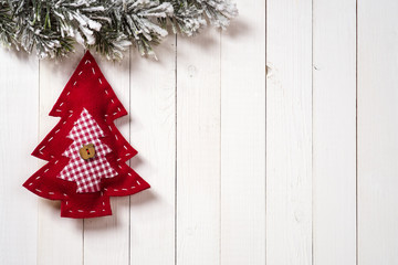 Christmas decoration with fir branches on the background of a tr