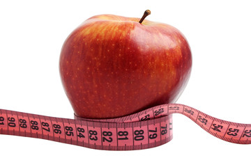 Diet concept - red apple and measuring tape