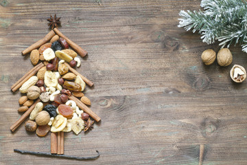Christmas tree with dried fruits and nuts abstract background