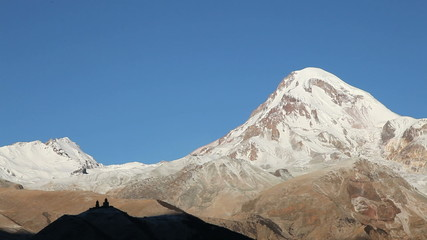 Silhouette of Gergeti Monastery and Mount Kazbek
