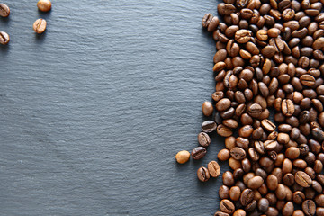 Fragrant fried coffee beans on a slate