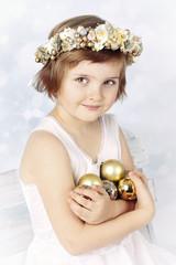 Beautiful little girl  holding christamas balls