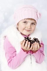 Pretty young girl holding cones