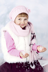 Beautiful girl holding snow