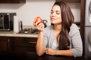 Eating an apple at home