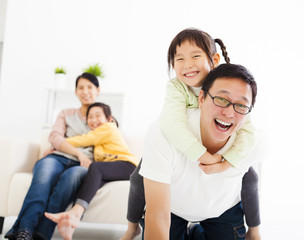 happy asian family in the living room
