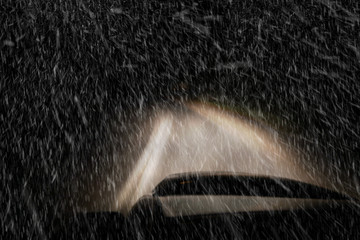 Driving a car at night in a snowstorm