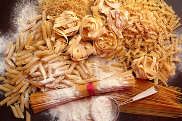 Variety of shapes and types of italian pasta