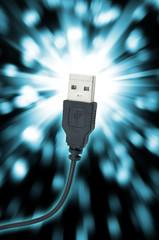Close up of USB plug isolated on bright flare background