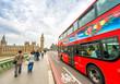 Obrazy na płótnie, fototapety, zdjęcia, fotoobrazy drukowane : London. Double Decker bus speeding up on Westminster Bridge