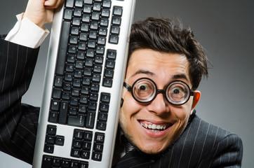 Computer geek with computer keyboard