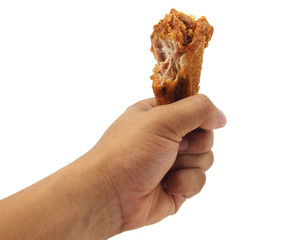 Hand hold fried chicken isolated on white