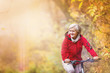 canvas print picture - Active senior woman ridding bike