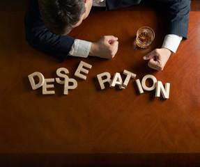 Word Desperation and devastated man composition