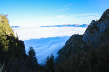 Mountain landscape at high altitude, with clouds and blue sky