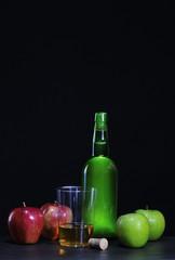 Cider bottle with apples..